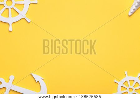 Summer holiday vacation background with starfish anchor and rudders in white. Copy space. Top view
