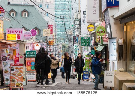 SEOUL SOUTH KOREA - OCT 31: Ewha shopping street the famous shopping area around Ewha Womans University for female teenage on October 31 2016 in Seoul South Korea