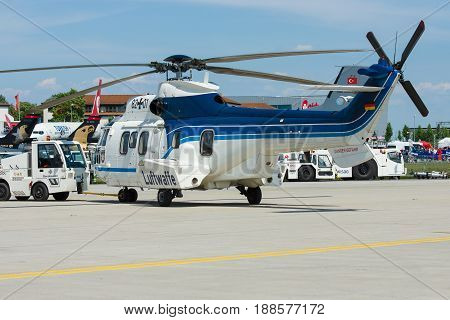BERLIN GERMANY - MAY 21 2014: Medium Utility Helicopter Eurocopter AS532 Cougar. German Air Force. Exhibition ILA Berlin Air Show 2014