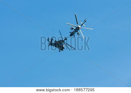 BERLIN GERMANY - MAY 21 2014: Demonstration flight of Eurocopter Tiger. The Eurocopter Tiger is a four-bladed twin-engined attack helicopter which first entered service in 2003. Exhibition ILA Berlin Air Show 2014