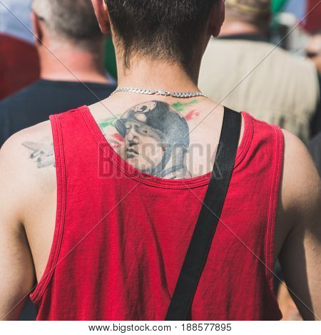 MILAN ITALY - MAY 27 2017: Detail of far-right activist marching in the city streets to protest against the rampant immigration demanding more support for Italian citizens.