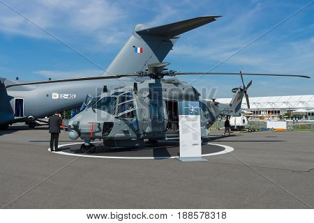 BERLIN GERMANY - MAY 21 2014: A medium sized twin-engine multi-role military helicopter - NH90 NFH (NATO Frigate Helicopter). German Army. Exhibition ILA Berlin Air Show 2014