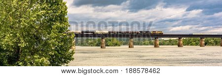 Louden Tennessee USA - May 25 2017: A freight train passes on a train tressle over the Tennessee River.