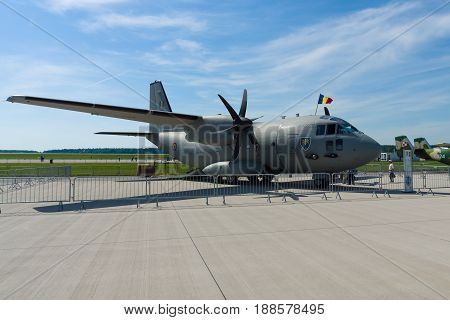 BERLIN GERMANY - MAY 21 2014: A medium-sized military transport aircraft Alenia C-27J Spartan. Romanian Air Force. Exhibition ILA Berlin Air Show 2014
