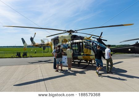 BERLIN GERMANY - MAY 21 2014: A twin-engine helicopter with a single four-bladed main rotor Eurocopter UH-72 Lakota. US Air Force. Exhibition ILA Berlin Air Show 2014