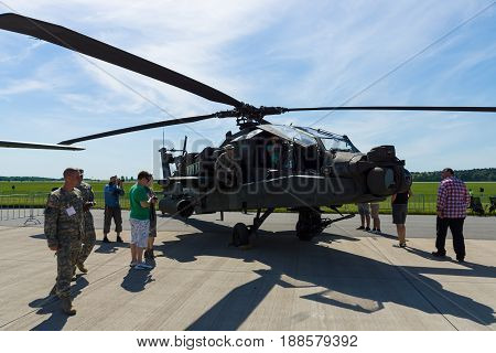 BERLIN GERMANY - MAY 21 2014: A four-blade twin-engine attack helicopter Boeing AH-64 Apache Longbow. US Air Force. Exhibition ILA Berlin Air Show 2014