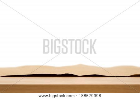 Brown paper on wood table - can be used for montage foods or products on top