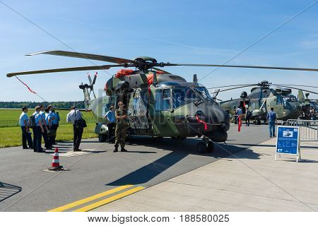 BERLIN GERMANY - MAY 21 2014: A medium sized twin-engine multi-role military helicopter NHIndustries NH90. German Army. Exhibition ILA Berlin Air Show 2014