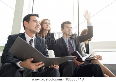 Business people sitting in group sharing meeting and learning