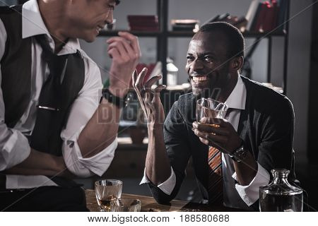 Cheerful Colleagues Drinking Alcohol While Spending Time Together After Work