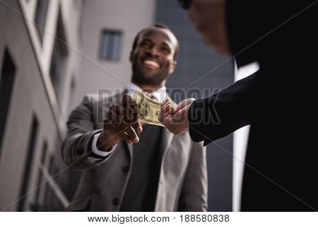 Young African American Businessman In Formalwear Taking Money Outdoors