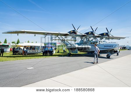 BERLIN GERMANY - MAY 21 2014: Bomber reconnaissance and air-sea rescue flying boat Dornier Do 24ATT Amphibian (modern replica). Exhibition ILA Berlin Air Show 2014