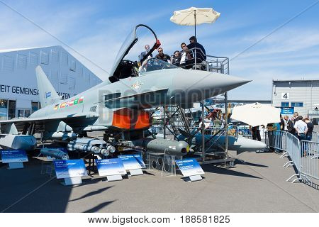 BERLIN GERMANY - MAY 21 2014: Multirole fighter Eurofighter Typhoon and samples of armament. Exhibition ILA Berlin Air Show 2014