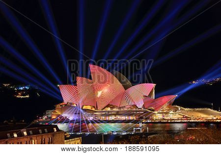 SYDNEY AUSTRALIA - MAY 29 2017; Converging lines and concentric geometry  Opera House illuminated with various moving designs and laser lights transform the sky during the Vivid Sydney annual public event.