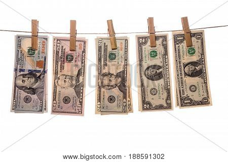 Dollar bills on clothespins on white background. Concept of laundering of money