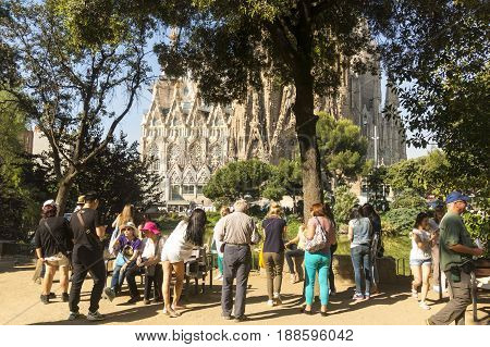 Tourists At Nativity Facade Of La Sagrada Familia - The Impressive Cathedral Designed By Gaudi. Barc