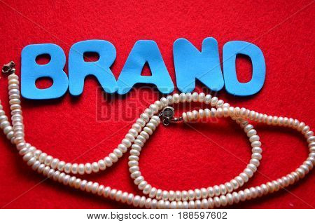 word brand on a  abstract red background