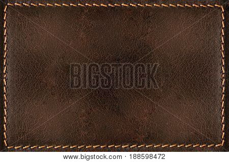 Dark brown leather texture background with seams