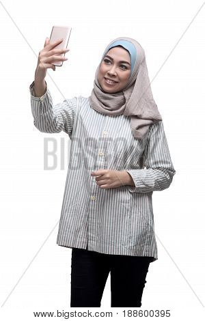 Happy Asian Muslim Woman Taking Selfie Picture With Handphone