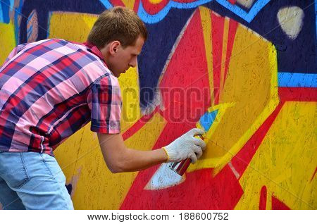 Kharkov, Ukraine - May 27, 2017: Festival Of Street Arts. Young Guys Draw Graffiti On Portable Woode