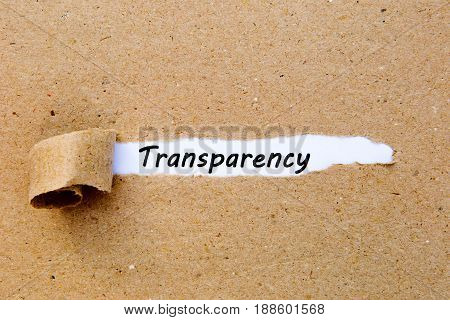 Transparency - printed text underneath torn brown paper