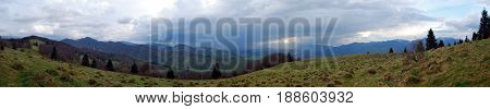 spectacular mountain panorama of Velka Fatra and Mala Fatra mountain ranges with many hills and meadows from Nolcovska Magura hill in Velka Fatra mountains in Slovakia during springtime