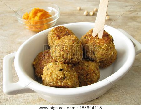 Homemade falafel balls fingerfood with carrots dip