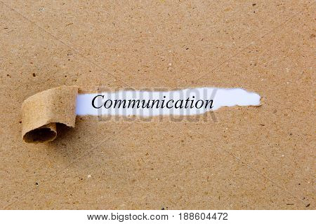 Communication - printed text underneath torn brown paper