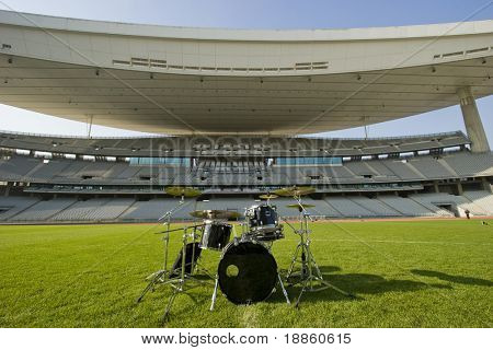 Empty Olympic Stadium And A Drum Set