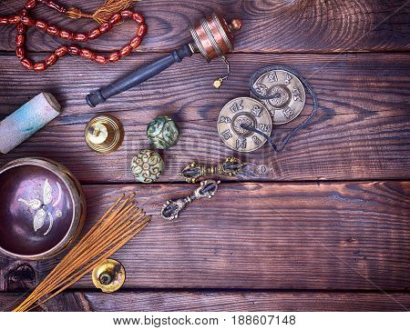 Musical religious instruments for Buddhist practices and meditations brown wood background