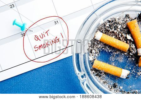 Quit Smoking Calendar date - with ashtray on blue background