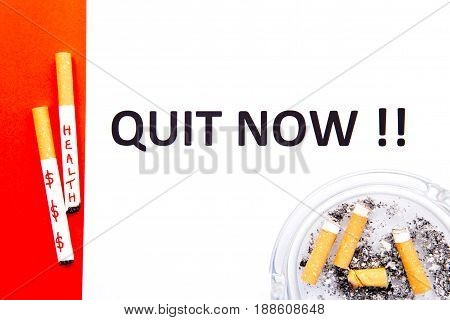 Stop Smoking - Quit Now - with cigarettes and ashtray on red and white background