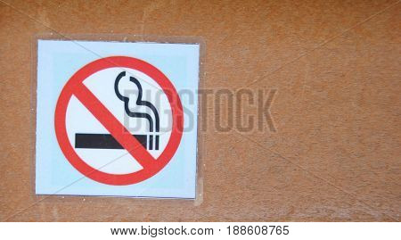 Don't smoke sign on wood texture background