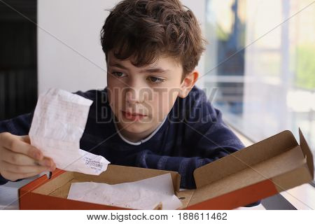 teenager boy check bill after dinner in pizzeria close up photo