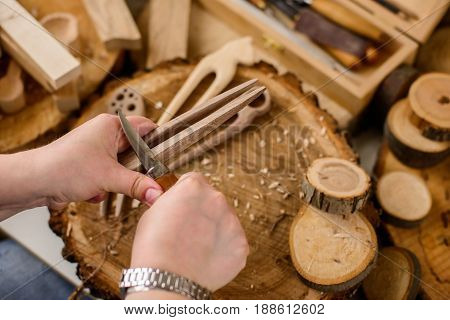 closeup of wood carver's work on rustic wooden background