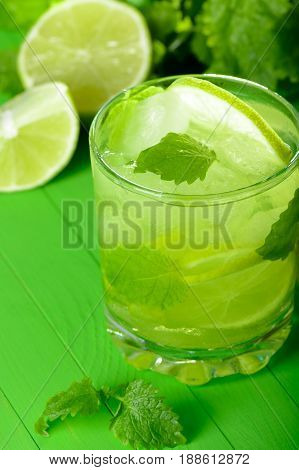 A Glass Of Lemonade With Lime And Mint
