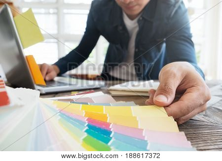 Man Working With Color Samples For Selection. Graphic Designer At Work. Color Swatch Samples.