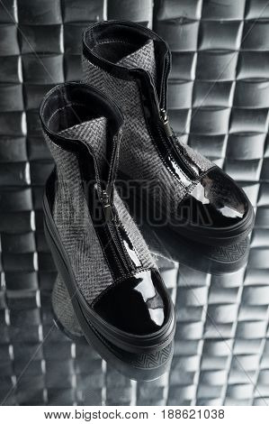 boots for women with zipper on the glass floor