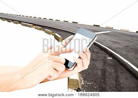 hand hold touch screen on smart phone or phone on the asphalt road in background