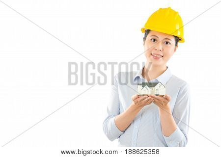 Woman Engineer Holding House Model