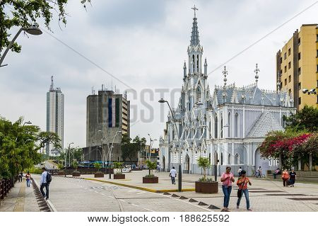 Cali Colombia - February 6 2014: People in a street in front of the La Ermita Church in city of Cali Colombia