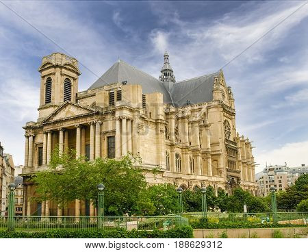 Western and southern facades of the Church of Saint-Eustache built in the 17th century in Gothic style with Renaissance elements in Paris France
