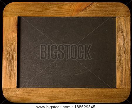 Old rough black chalk board in a brown wooden frame