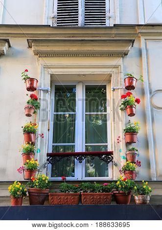 Window on Montmartre in Paris France .