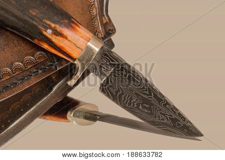 The fine details in the pattern of the Damascus steel show the skill of the smith