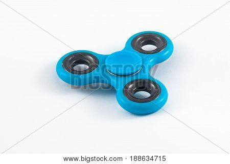 Fidget Spinner in white isolated background for stress release during work