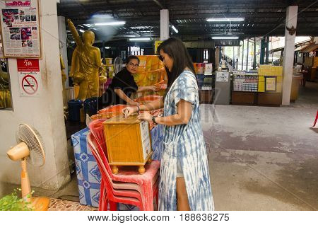 Thai Woman Donate Money And Offering To The Monk At Wat Prommanee
