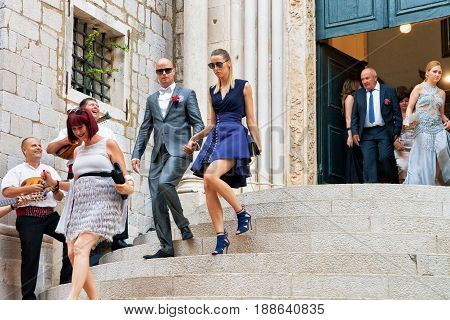 Guests At Wedding Ceremony At Church In Dubrovnik