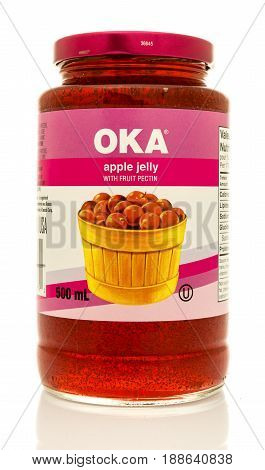 Winneconne WI - 16 May 2017: A jar of OKA apple jelly with fruit pectin on an isolated background.
