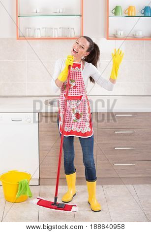 Cleaning Lady Singing In Kitchen